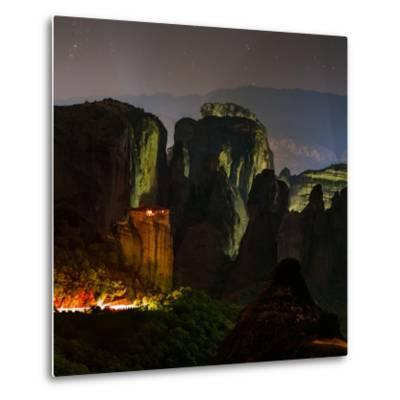 Light Shines on a Monastery Perched on a Sandstone Cliff-Babak Tafreshi-Metal Print