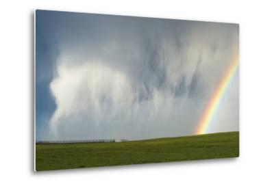 A Thunderstorm Produces a Curtain of Falling Hailstones Next to a Rainbow-Jim Reed-Metal Print