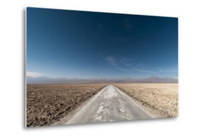 An Empty Road Through a Salt Flat in the Salar De Atacama-Sergio Pitamitz-Metal Print