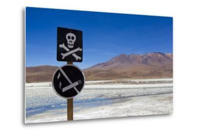 A Skull and Cross Bones Danger Sign on Edge of a Dried Up Lagoon-Mike Theiss-Metal Print