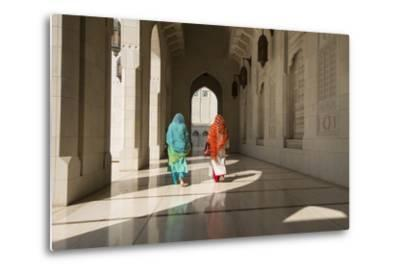 Two Traditionally Dressed Women Walk in a Corridor of the Sultan Qaboos Grand Mosque-Michael Melford-Metal Print