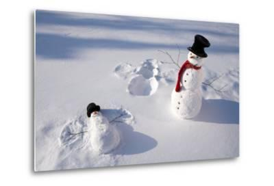 Snowmen in Forest Making Snow Angel Imprint in Snow in Late Afternoon Sunlight Alaska Winter-Design Pics Inc-Metal Print