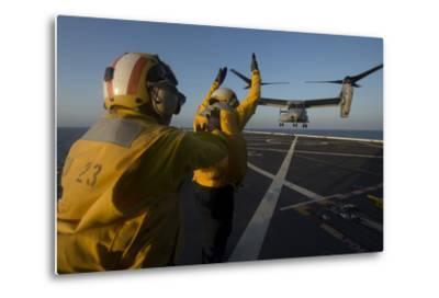 Aviation Boatswain's Mates Direct an MV-22 Osprey on the Flight Deck--Metal Print