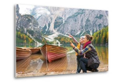 Happy Mother and Baby Pointing on Copy Space While on Lake Braies in South Tyrol, Italy-Mr Alliance-Metal Print