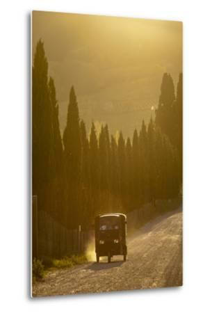 A Three Wheeled Van Drives Up a Dirt Road Lines with Cypress Trees-Tino Soriano-Metal Print