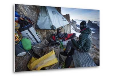 Expedition Team Members Try to Stay Warm on a Ledge of Bertha's Tower,1,200 Feet Above the Ground-Cory Richards-Metal Print
