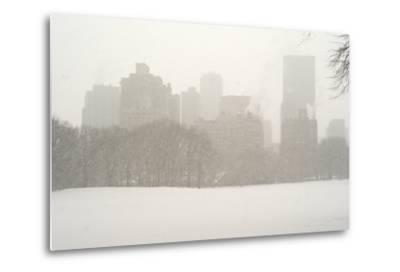 Manhattan Buildings and Trees in Central Park During a Blizzard-Kike Calvo-Metal Print