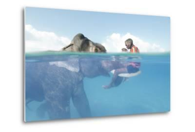 A Mahout, Sits on the Tusks of Rajan, the Elephant, in the Andaman Islands-Cesare Naldi-Metal Print