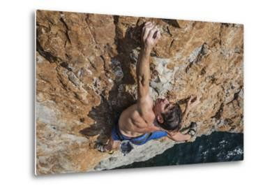A Climber, Without Ropes, Scales a Cliff Rising from the Gulf of Oman-Jimmy Chin-Metal Print