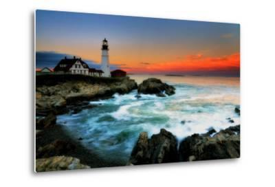 The Sun Setting Behind the Portland Head Light as Waves Surge onto the Rocky Shore-Robbie George-Metal Print