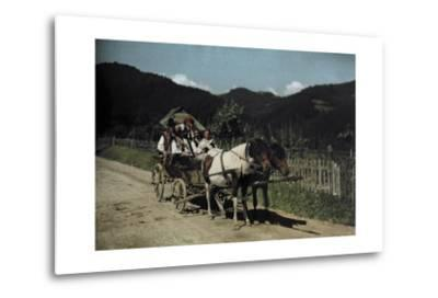 People Ride in a Cart Pulled by Two Horses-Hans Hildenbrand-Metal Print