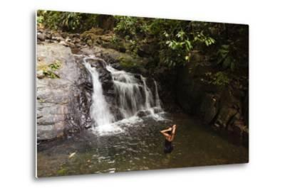 A Woman Standing in a Pool at the Base of a Small Waterfall-Sergio Pitamitz-Metal Print