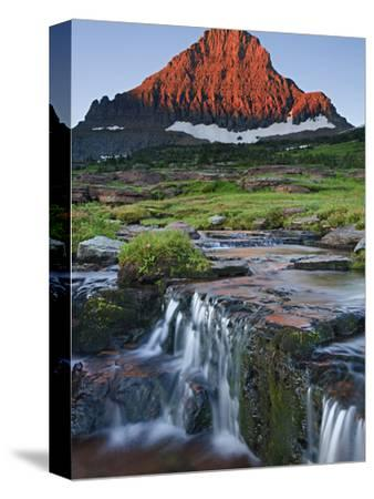Mount Reynolds in Early Morning Light and a Seasonal Waterfall, Glacier National Park, Montana, USA-Geoffrey Schmid-Stretched Canvas Print