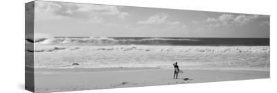 Surfer Standing on the Beach, North Shore, Oahu, Hawaii, USA--Stretched Canvas Print