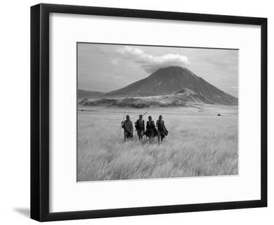 Maasai Warriors Stride across Golden Grass Plains at Foot of Ol Doinyo Lengai, 'Mountain of God'-Nigel Pavitt-Framed Premium Photographic Print