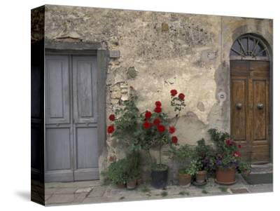 Tuscan Doorway in Castellina in Chianti, Italy-Walter Bibikow-Stretched Canvas Print