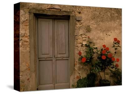 Tuscan Doorway, Castellina, Il Chianti, Tuscany, Italy-Walter Bibikow-Stretched Canvas Print