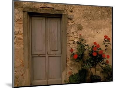 Tuscan Doorway, Castellina, Il Chianti, Tuscany, Italy-Walter Bibikow-Mounted Photographic Print