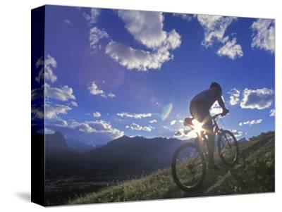 Mountain Biker at Sunset, Canmore, Alberta, Canada-Chuck Haney-Stretched Canvas Print
