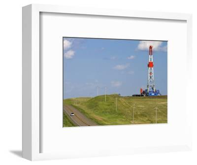 Patterson Uti Oil Drilling Rig Along Highway 200 West of Killdeer, North Dakota, USA-David R^ Frazier-Framed Photographic Print