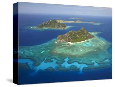 Monuriki Island and Coral Reef, Mamanuca Islands, Fiji-David Wall-Stretched Canvas Print