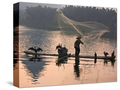 Fisherman Fishing with Cormorants on Bamboo Raft on Li River at Dusk, Yangshuo, Guangxi, China-Keren Su-Stretched Canvas Print