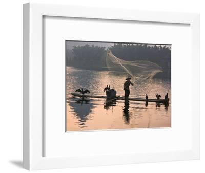 Fisherman Fishing with Cormorants on Bamboo Raft on Li River at Dusk, Yangshuo, Guangxi, China-Keren Su-Framed Photographic Print