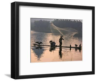 Fisherman Fishing with Cormorants on Bamboo Raft on Li River at Dusk, Yangshuo, Guangxi, China-Keren Su-Framed Photographic Print
