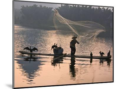 Fisherman Fishing with Cormorants on Bamboo Raft on Li River at Dusk, Yangshuo, Guangxi, China-Keren Su-Mounted Photographic Print