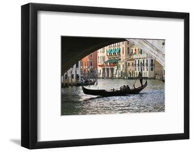 Tourist in a Gondola as They Pass under the Rialto Bridge, Venice, Italy-David Noyes-Framed Photographic Print