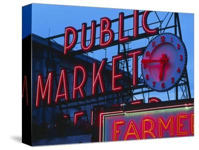 View of Public Market Neon Sign and Pike Place Market, Seattle, Washington, USA-Walter Bibikow-Stretched Canvas Print