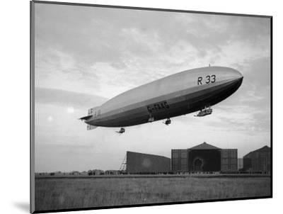 Armstrong Whitworth R33 Airship Outside the Hangars at Pulham in Norfolk, April 1925--Mounted Photographic Print