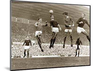 Manchester United vs. Arsenal, Football Match at Old Trafford, October 1967--Mounted Photographic Print