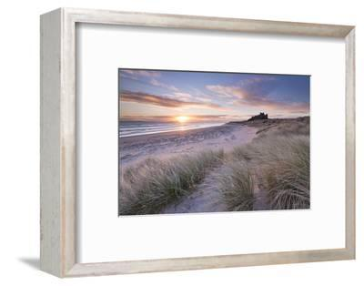 Sunrise over Bamburgh Beach and Castle from the Sand Dunes, Northumberland, England. Spring (March)-Adam Burton-Framed Photographic Print