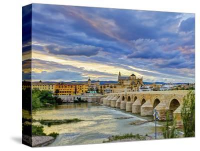 Roman Bridge Over Guadalquivir River and Mezquita, Cordoba, Cordoba Province, Andalucia, Spain-Alan Copson-Stretched Canvas Print