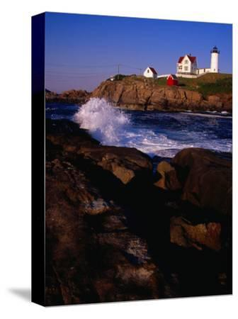 Surf Crashing on York Beach with Nubble Lighthouse in Background, Cape Neddick, USA-Levesque Kevin-Stretched Canvas Print