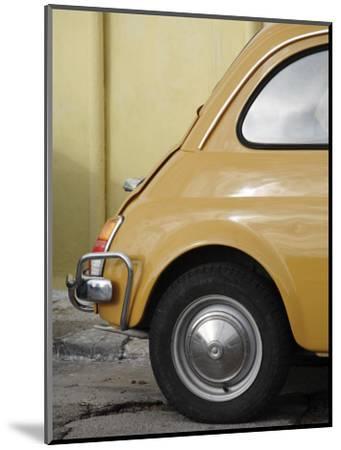 Yellow Fiat 500 Parked Against Wall, Gallipoli-David Borland-Mounted Photographic Print