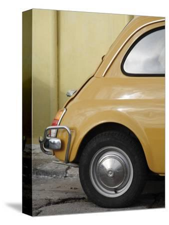 Yellow Fiat 500 Parked Against Wall, Gallipoli-David Borland-Stretched Canvas Print