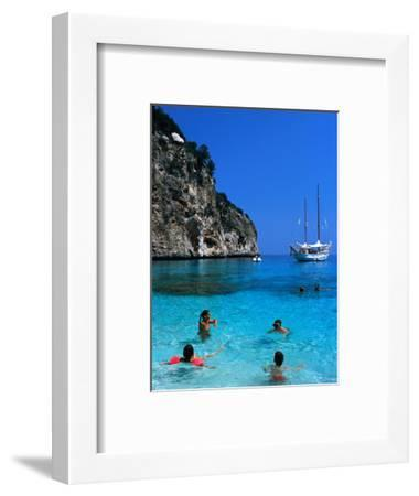 Tourists Swimming in Waters of Cala Mariolu in Gulf of Orosei, Sardinia, Italy-Dallas Stribley-Framed Photographic Print