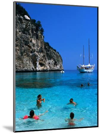 Tourists Swimming in Waters of Cala Mariolu in Gulf of Orosei, Sardinia, Italy-Dallas Stribley-Mounted Photographic Print