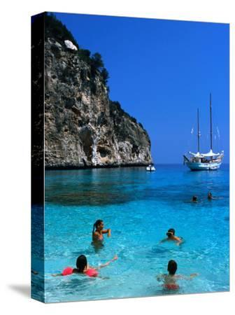 Tourists Swimming in Waters of Cala Mariolu in Gulf of Orosei, Sardinia, Italy-Dallas Stribley-Stretched Canvas Print