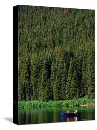 Boating on Cameron Lake, Waterton Lakes National Park, Alberta, Canada-Lawrence Worcester-Stretched Canvas Print