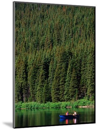 Boating on Cameron Lake, Waterton Lakes National Park, Alberta, Canada-Lawrence Worcester-Mounted Photographic Print