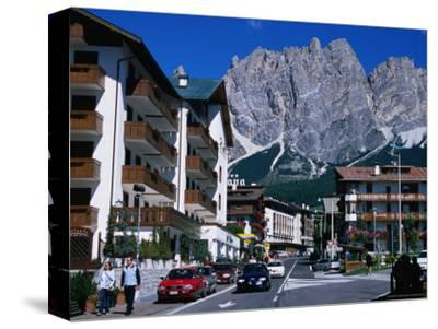 Apartment Buildings with Cliffs of Cristallo Group Behind, Cortina, Veneto, Italy-Grant Dixon-Stretched Canvas Print