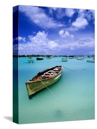 Fishing Boats Anchored in Lagoon-Olivier Cirendini-Stretched Canvas Print