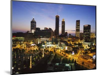 Buildings Lit Up at Sunset, Centennial Olympic Park, Atlanta, Georgia, USA--Mounted Photographic Print