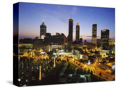 Buildings Lit Up at Sunset, Centennial Olympic Park, Atlanta, Georgia, USA--Stretched Canvas Print