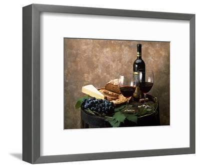 Still Life of Wine Bottle, Wine Glasses, Cheese and Purple Grapes on Top of Barrel--Framed Photographic Print