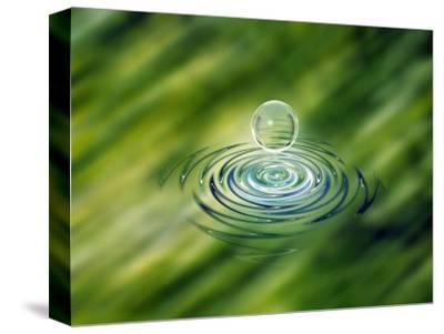 Clear Bubble Rising from Ripples in Mottled Green Water--Stretched Canvas Print