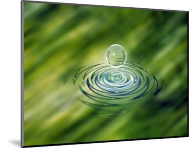 Clear Bubble Rising from Ripples in Mottled Green Water--Mounted Photographic Print